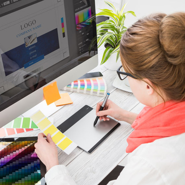 a graphic designer at her computer designing a logo